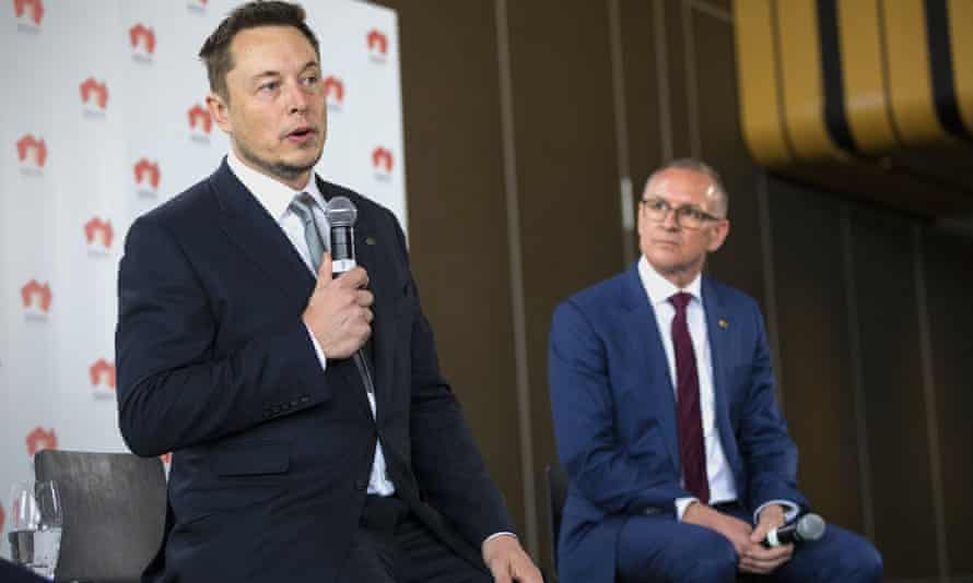 South Australian premier Jay Weatherill listens to Tesla chief executive officer Elon Musk speak during an official ceremony in Adelaide to announce that Tesla will install the world's largest grid-scale battery in the South Australian state.