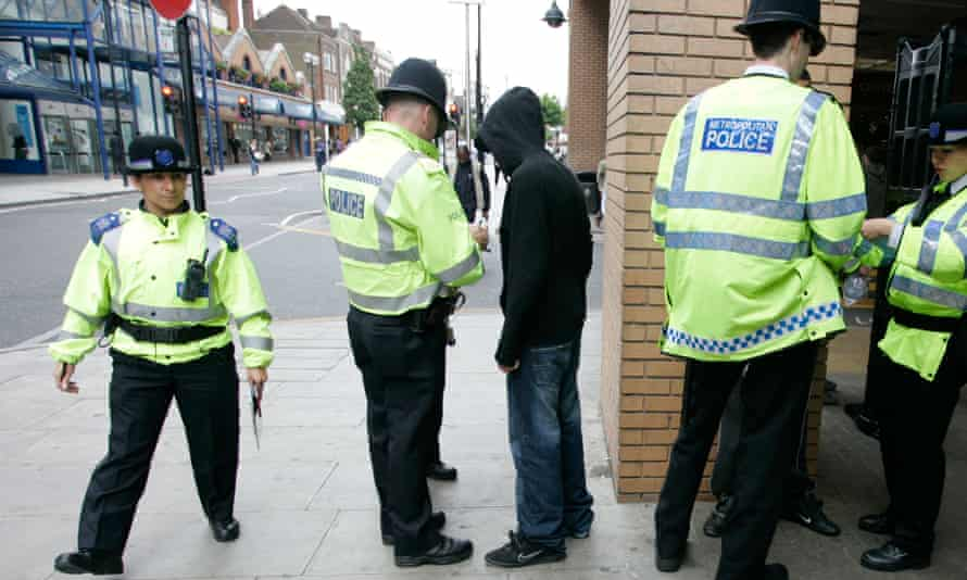 police performing a stop and search in harrow, north-west london