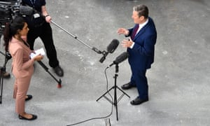 Photograph looking down on Keir Starmer giving a socially distanced broadcast interview