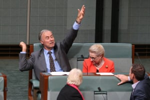 John Alexander looks like he is demonstrating how to serve a tennis ball during a division in the House of Representatives this evening, Monday 18th April 2016.