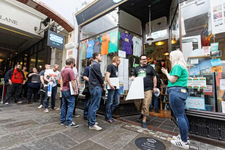 Fans queue outside Spillers Records in Cardiff.