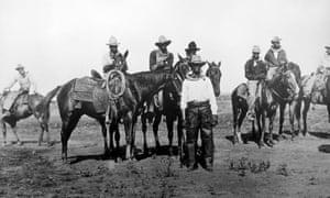 Black cowboys preparing to race at a state fair in Bonham, Texas, circa 1913.