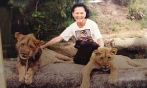 Mary Tandon with young lions in a wildlife reserve in Zimbabwe