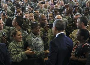 Barack Obama greets members of the military at MacDill air force base.