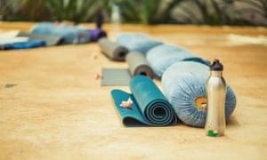 yoga cushion, mat and water bottle