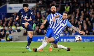Tottenham's Son Heung-min fires a shot past Brighton's Shane Duffy but is denied by a fine save from the Seagulls' keeper Mathew Ryan.