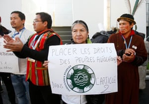 Indigenous people demonstrate for their rights to be included as a binding part of the UN climate pact