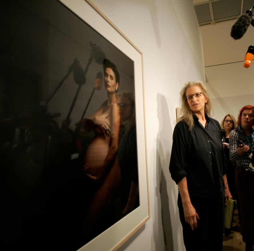 Photographer Annie Leibovitz poses with her Vanity Fair Demi Moore cover.