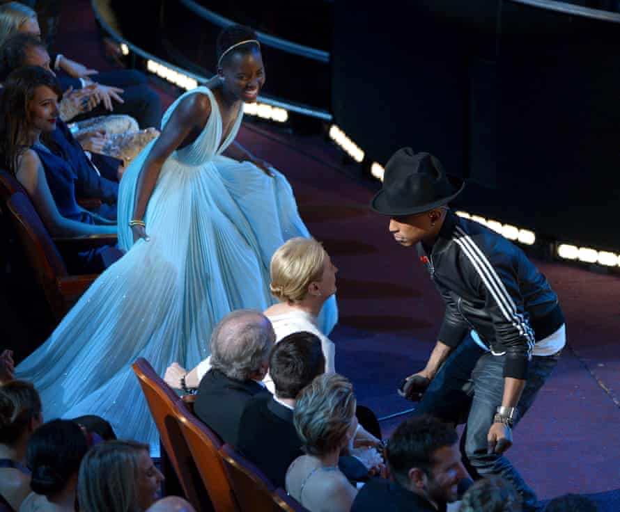 Delighted with their DrainWigs … Lupita Nyong'o and Meryl Streep dance with Pharrell Williams at the 2014 Oscars.