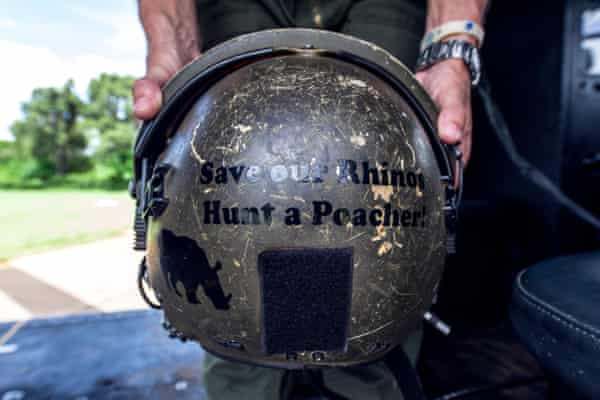Airforce helmet with an anti-poaching slogan on the back.