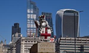 A dragon boundary mark and the City of London skyline.