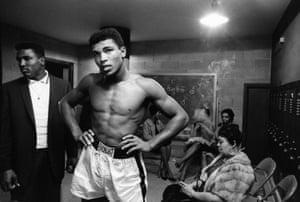 Cassius Clay (Muhammad Ali) in locker room at his home, 1961