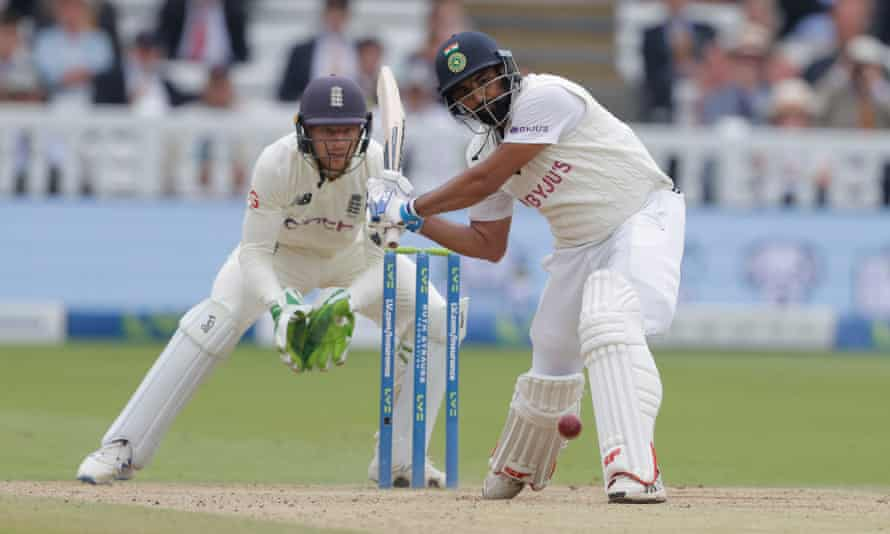 Mohammed Shami launches a shot off Moeen Ali during his unbeaten 56.