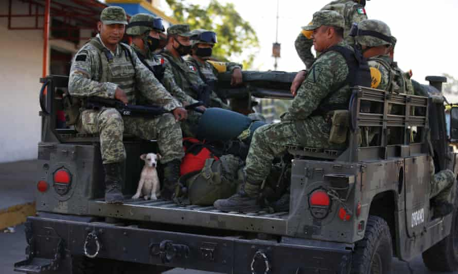 Mexican soldiers the morning after an overnight patrol along the natural border with Guatemala Ciudad Hidalgo, Mexico, on 21 January.