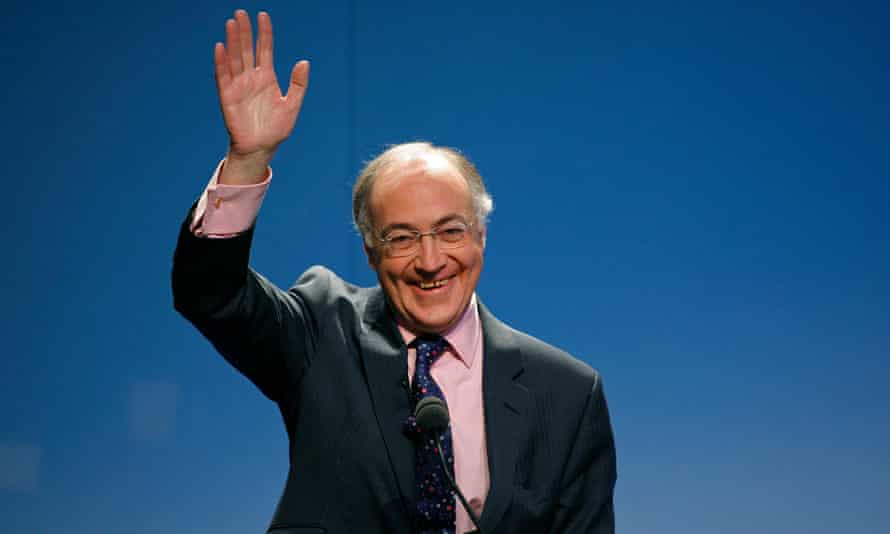 Michael Howard waves at a Conservative party conference