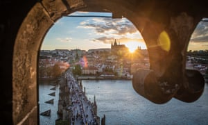 An aerial view of diners sitting at a gigantic table measuring 515 meters in length and spanning the entirety of the iconic Charles Bridge in Prague, Czech Republic.