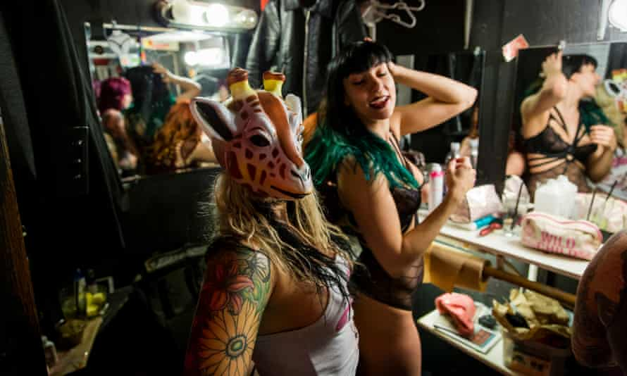 Dancer Toxic tries on one of the masks she sometimes wears during performances.