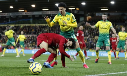 Jamal Lewis battles with Mo Salah during Norwich's game at home against Liverpool in February.