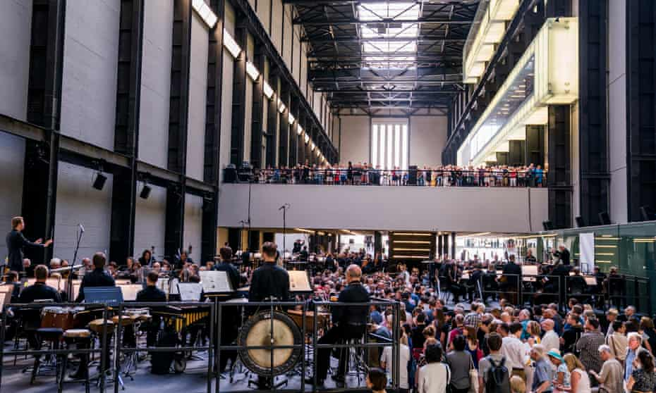 Sir Simon Rattle, Matthias Pintscher and Duncan Ward conduct the three ensembles in the Turbine Hall.