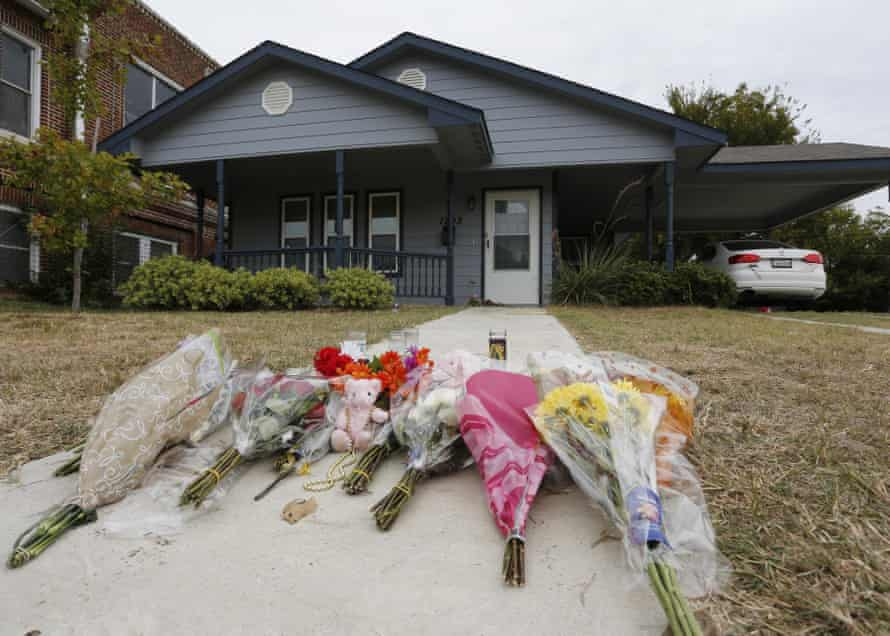 Flowers lie on the sidewalk in front of the house in Fort Worth where a police officer killed Atatiana Jefferson.