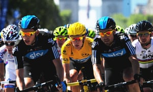 Bradley Wiggins, in the yellow jersey, rides with Team Sky team-mates Bernhard Eisel (right), Mark Cavendish (second right) and Christian Knees (left) during the 2012 Tour de France.