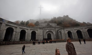 People leave after attending mass at the basilica where the tombs of Spain's former dictator General Franco and de Rivera lie, near Madrid.