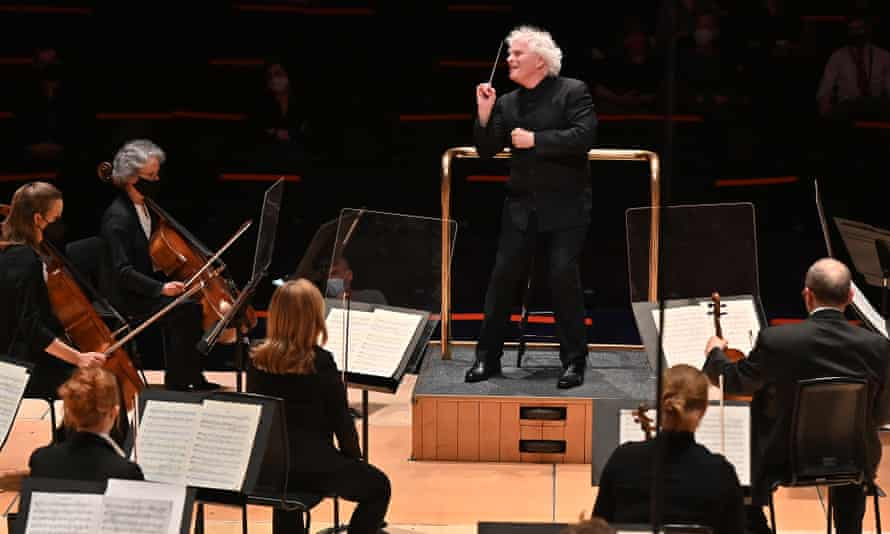Sir Simon Rattle conducts the LSO at the Barbican, the first concert before a live audience after 14 months away