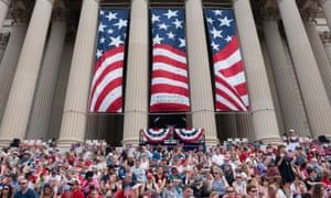 Parade-goers sit at the National Archives for the reading of the Declaration of Independence and the Independence Day parade along Constitution Avenue in Washington DC.