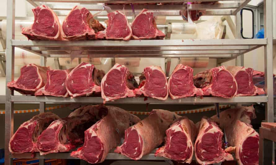 Sirloin joints of beef in abattoir, Yorkshire, England.