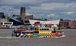 Mersey Ferry in dazzle livery against the backdrop of the Pier Head, Museum of Liverpool, Liverpool Cathedral and Albert Dock