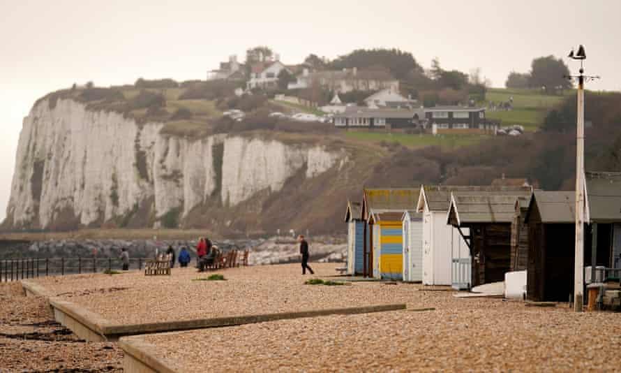 People walk on the beach at Kingsdown, near Deal