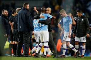 Manchester City manager Pep Guardiola celebrates with Fernandinho after the final whistle.