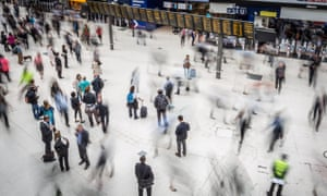 Commuters at Waterloo station in London. Workers in the south-east have benefited most from a rise in earnings in the year to April.