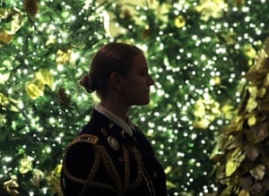 A military aide stands near Christmas decorations in the Grand Foyer at the White House.