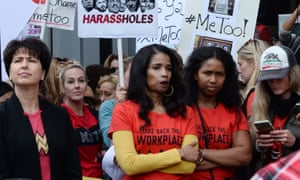 Demonstrators participate in a #MeToo march In Los Angeles.