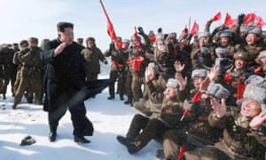 Kim Jong-un waves at pilots of the Korean people's army.