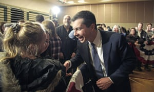 Buttigieg meets with members of the audience following an election rally in Sioux City, Iowa, on Thursday.