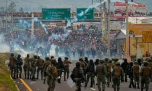 Demonstrators and riot police clash in Quito.