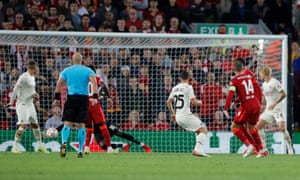 Liverpool's Jordan Henderson scores their third goal.