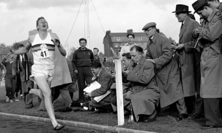 Roger Bannister hits the tape to become the first person to run a sub-four-minute mile, on 6 May 1954 in Oxford, England.