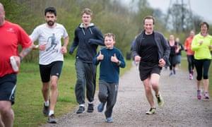 George Shepherd (centre) running his 50th park run on his 12th birthday.