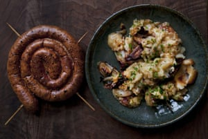 Nigel Slater's cumberland sausage with shallot and cheddar roast potato mash.