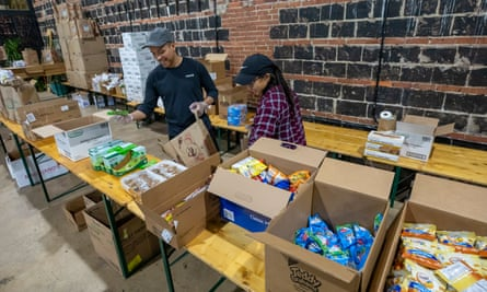 Volunteers at Hook Hall prepare care packages for scores of suddenly unemployed restaurant and hospitality workers in Washington DC.