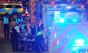 Members of the emergency services tend a person injured in the attack on London Bridge on 3 June 2017.