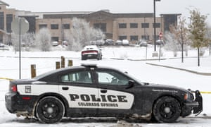 A police car blocks the entrance to the Planned Parenthood clinic in Colorado Springs where a gunman opened fire on Friday, killing three people.