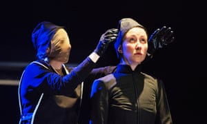 Erin Doherty, pictured with a masked Sophie Melville in The Divide.