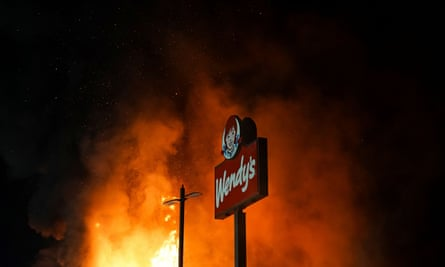 The Wendy's restaurant where Rayshard Brooks was shot dead burns on Saturday.