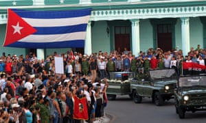 Cubans gather to watch the motorcade carrying the ashes of late Cuban leader Fidel Castro is in Camaguey, Cuba, on Friday.