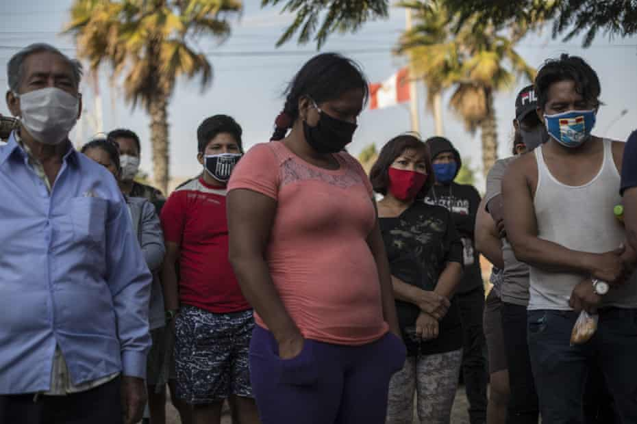 Migrants from Iquitos attend Mass at a makeshift camp created in Lima.
