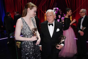 Mel Brooks and Emma Stone chat backstage after the ceremony